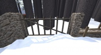 A Rounded stone iron fence gate