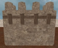 A Tall rendered stone wall